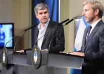 CONFERENCIA. El jefe de Gabinete y el ministro del Interior anunciaron la convocatoria al diálogo.